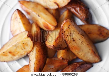 Baked potatoes on pate close up