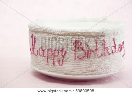 Birthday cake on light background