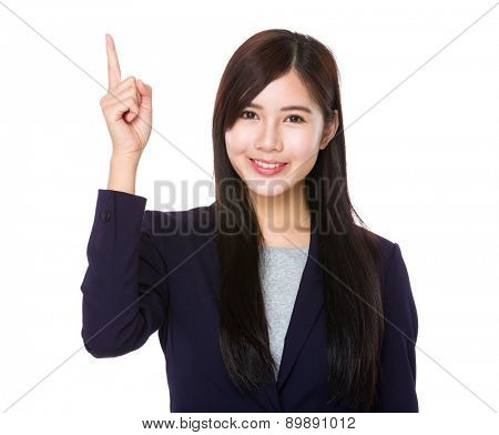 Businesswoman with finger showing upwards