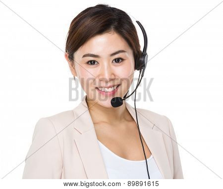 Businesswoman with headset for supporting servies