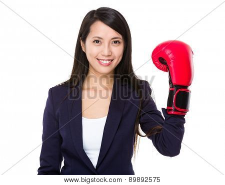 Young businesswoman wear of plastic boxing gloves