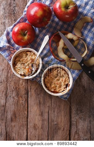 Apple Crumble In Portion Pots On The Table. Vertical Top View