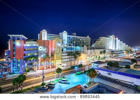 DAYTONA BEACH, FLORIDA - JANUARY 3, 2015: Hotels line downtown Daytona Beach at night. The city is a popular beachfront destination.