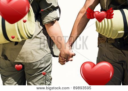 Hitch hiking couple standing holding hands on the road against hearts
