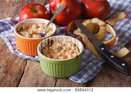 Crumble With Apples Close-up In The Pot On The Table
