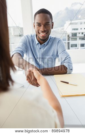 Handshake to seal a deal after a business meeting in the office