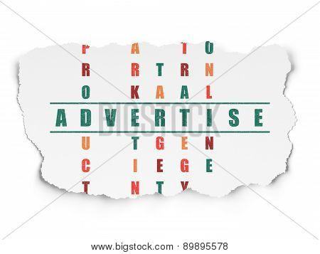 Advertising concept: word Advertise in solving Crossword Puzzle