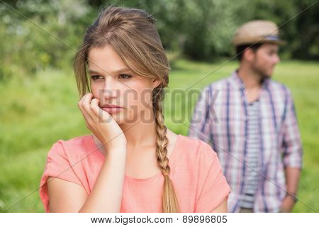 Couple not talking after argument on a sunny day