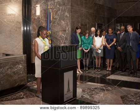 NEW YORK - MAY 5, 2015: NY First Lady Chirlane McCray holds a moment of silence for slain NYPD Officer Brian Moore, who was killed in the line of duty, before a ceremony at the Empire State Building.