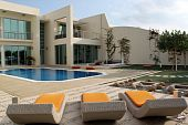 stock photo of mansion  - Modern mansion with swimong pool in the back yard - JPG