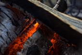 stock photo of firewood  - Burning smolder firewood in the fireplace close up - JPG