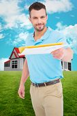 stock photo of postman  - Postman with letter against blue sky - JPG