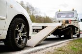 image of tow-truck  - Loading broken car on a tow truck on a roadside  - JPG