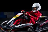 pic of armored car  - Young girl karting racer isolated - JPG