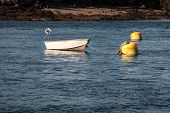image of dory  - Small rowboat on cove in the atlantic ocean - JPG