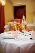 stock photo of champagne glasses  - two glasses of champagne on the table - JPG