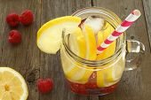picture of masonic  - Detox water with lemon and raspberries in a mason jar with straw - JPG