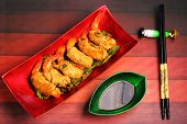 stock photo of deep  - traditional Vietnam deep fried shrimp and pork rolls in breadcrumbs served on a wood table top - JPG