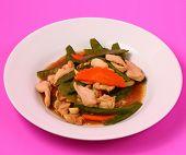 stock photo of stir fry  - chicken stir fry thai style on a pink background - JPG