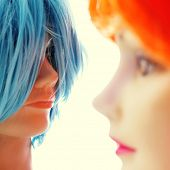 pic of dress mannequin  - closeup of some wigs of different colors on mannequin heads - JPG