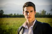 picture of grassland  - Handsome young man at countryside - JPG