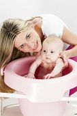 image of bathing  - portrait of mother with her baby during bathing - JPG