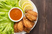 picture of chicken wings  - Top view fried chicken wings on wooden background - JPG