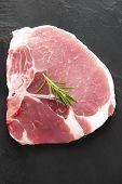 picture of pork chop  - Top view raw pork chop on blackboard - JPG