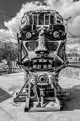 picture of scrap-iron  - Welded car scrap metal formed into a human head with eyes and facial features - JPG