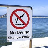 picture of sky diving  - A sign indicating that there is to be no diving in the shallow water - JPG