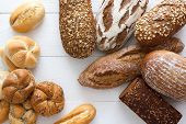 stock photo of bread rolls  - Many mixed breads and rolls shot from above - JPG