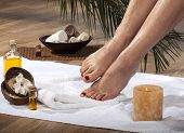 stock photo of wet feet  - Female feet with drops of water on spa background - JPG