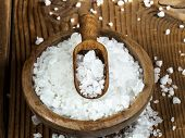 image of salt-bowl  - Sea salt in bowl and spoon on a wooden background - JPG