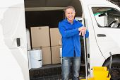 foto of cleaning agents  - Cleaning agent standing and smiling at camera in front of his van - JPG