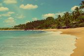 beautiful tropical beach landscape with clouds - vintage retro style