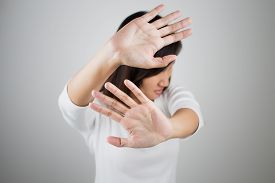 foto of no entry  - Young woman showing her denial with NO on her hand - JPG