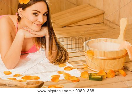Young Woman Relaxing In Sauna. Spa Wellbeing.