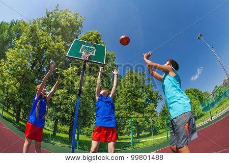 Fisheye view of children jumping for flying ball