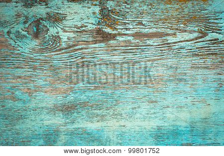 Old weathered plank painted in blue