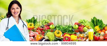 Medical doctor woman over Diet and health care background.
