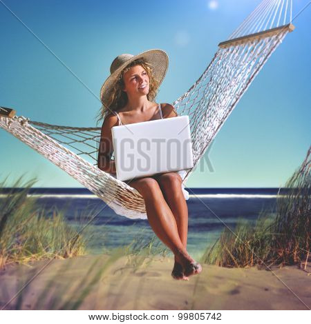 Beautiful Woman Sitting on a Hammock by the Beach Concept