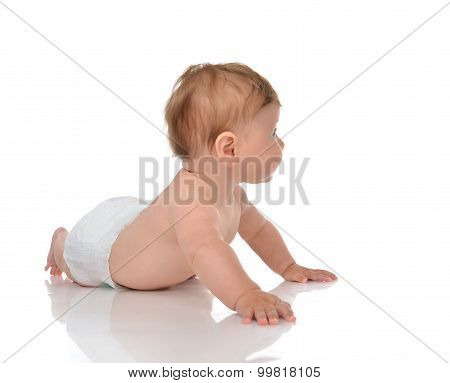 Five Month Infant Child Baby Girl In Diaper Lying Happy Looking At The Corner