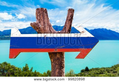 Russia Flag wooden sign with lake background