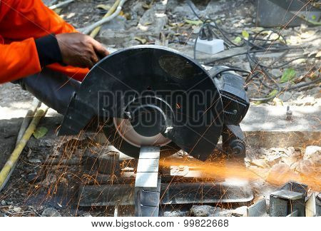 Worker Cutting Metal  With Saw Disk
