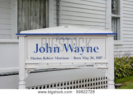 WINTERSET, IOWA - AUGUST 20, 2015: Sign at the John Wayne Birthplace. On the grounds of the museum that opened to the public in May of 2015.