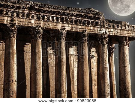 Baalbeck castle in the night, beautiful full moon and starry sky, ancient Arabian architecture, religious building, travel and tourism concept