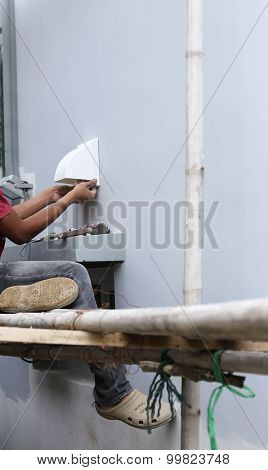Unidentified Builder Making Construction For Ventilation