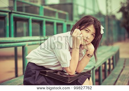 Shy Asian Thai Schoolgirl Student In High School Uniform Education Fashion Is Sitting On A Metal Sta