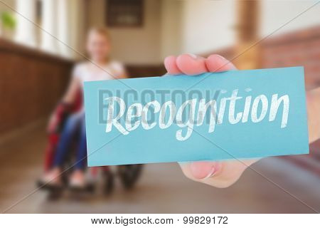 The word recognition and hand showing card against cute pupils writing at desk in library