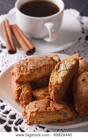 Cantuccini With Almonds And Coffee With Cinnamon Close-up. Vertical